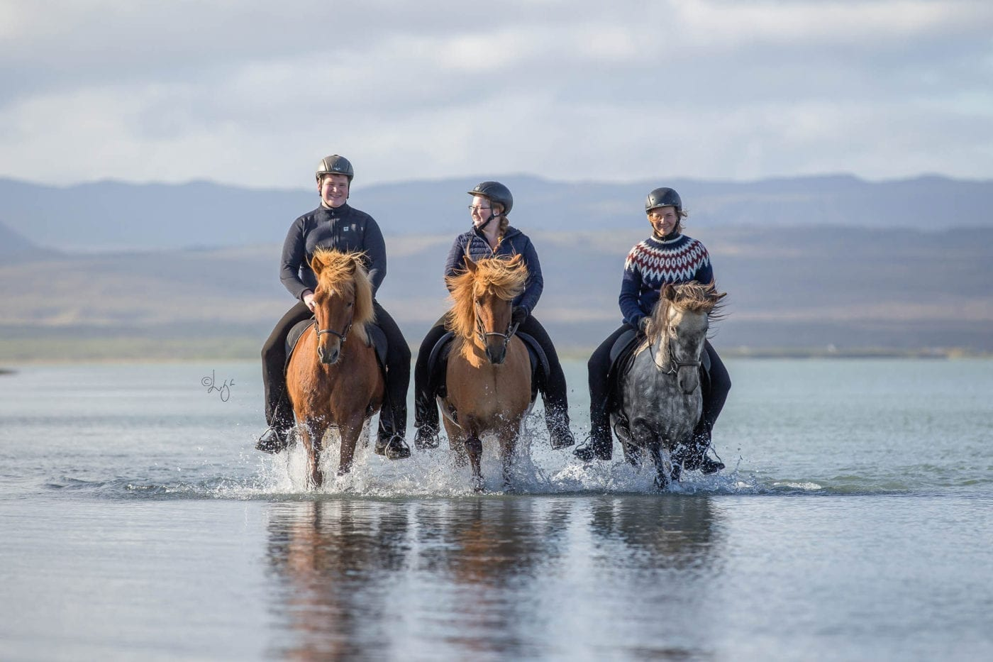 Riding on the black beach in iceland